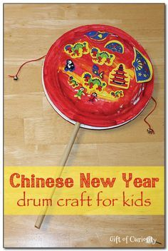 Chinese New Year drum craft for kids from Gift of Curiosity ✧≪∘∙✦✧•*•. ஐ ✦⊱Pinterest @Kawaii Duck ⊰✦ ღ Follow to discover more ஐ✧•*• Happy Lunar New Year•*•✧≪∘