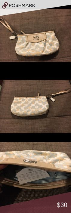 Coach Collection Beige Clutch/Wristlet This adorable clutch/ Wristlet from the Coach Collection is a perfect use if you do not wish to walk around with a big bag. It's great size is convenient for carrying all your small personal belongings. The beautiful colors of blue and beige make it a great accessory with any outfit. It's antique value and excellent condition make it a great buy! Authentic. Coach Bags Clutches & Wristlets
