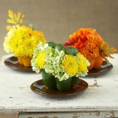Cute bell pepper and flower combos! Details: http://www.midwestliving.com/homes/seasonal-decorating/easy-fall-decorating-projects/page/48/0