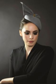 Made from peachbloom felt, Hazel is a luxurious cocktail hat with a hand formed fan detail, which attaches with a small textured brass clasp.