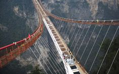 The construction of a bridge set to become the longest glass-bottomed walkway in the world is nearing completion. The first of the large glass panels has been installed on the skywalk bridge which hangs above a canyon in the stunning Tianmenshan National Forest Park in south central China's Hunan province.