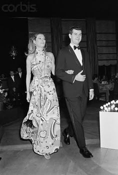 "12/6/1968-New York: Nan Kempner, one of society's leading ladies, was in the spotlight during a benefit fashion show held in New York (11/22) . Mrs. Kempner wore a nouveau print harem outfit fashioned in a new fabric called ""Touch."""