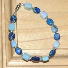 @Overstock.com - Susen Foster Silverplated Bluebonnets Multi-gemstone Bracelet - This light and lovely womens bracelet from Susen Foster closes with a magnetic clasp. A combination of deep blue Variscite ovals, translucent Peruvian blue opals, and tiny silverplated beads, this bracelet will highlight any look.  http://www.overstock.com/Main-Street-Revolution/Susen-Foster-Silverplated-Bluebonnets-Multi-gemstone-Bracelet/6095296/product.html?CID=214117 $29.49
