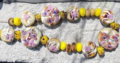 Tab beads on Raku base, decorated with white veins and leaves, roses and little flowers and spacers on yellow and Raku Little Flowers, Lampwork Beads, Glass Beads, Roses, Leaves, Yellow, Handmade, Decor, Hand Made