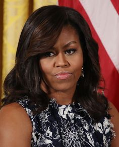 Michelle Obama Just Wore the Most Unpredictable Floral Dress We've Ever Seen Michelle Obama Quotes, Michelle And Barack Obama, Michelle Obama Hairstyles, American First Ladies, News Around The World, Champion, Hair Cuts, Pure Products, Lady