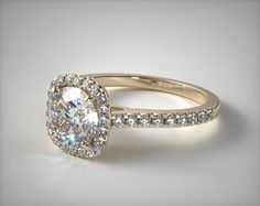 SKU 49621 - The nostalgic outline of a cushion shape diamond coupled with the fire and brilliance of a round brilliant center stone holds all the best attributes of both shapes. Also available as a traditional halo following the same lines as the diamond of your choice. *Please allow additional time for fancy shape diamonds and gemstones.*