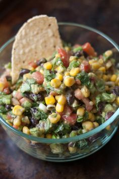 Ingredients  1- 15 oz can corn 1 can black beans 2 avocados (cubed) 2/3 cup chopped cilantro 8 green onion stalks, sliced 6 roma tomatoes Dressing:  1/4 cup olive oil 1/4 cup red wine vinegar 2 cloves minced garlic 3/4 teaspoon salt 1/8 teaspoon pepper 1 teaspoon cumin Mix first 6 ingredients together.  Combine dressing ingredients and pour over corn mixture.  Serve with tortilla chips