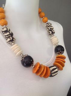 African tribal statement necklace, in black, white and orange, batik bone, white bone and wood. Wire wrapped on chain - Michela Rae