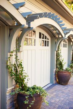 A pergola right about your garage door is the perfect way to accentuate your door & make it stand out from the rest of your home. Pergolas are great in adding a little bit of extra shade & they are perfect for letting climbing vines grow and frame your doors. Making a pergola is easy & only takes some simple wood working skills.