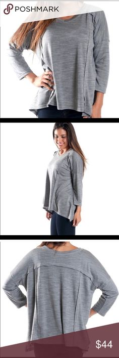 Comfy Gray Sloushy Top Blouse Gray Slouchy TopOur Paige Slouchy top. This top features a deep v-neck and 3/4 sleeves. Details: 3/4 length sleeves, v-neckline Fit: Loose, oversize style 81% Polyester/19% Viscose Machine wash cold. Complete care instructions on tags. Imported. Thanks again for checking out my closet. I'll consider all offers on my items. Thanks  Tops