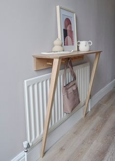 Your hallway is small and the only space you have has a pesky radiator in the way. This oak hallway stand fits neatly above for that all important shelf space plus hooks for your bag and scarf Radiator Shelf, Radiator Cover, Radiator Ideas, Small Hallways, Small Furniture, House Furniture, Furniture Projects, Wall Shelves, Hallway Shelf