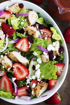 A mouthwatering salad with fresh strawberries, cranberries, goat cheese and almonds.  The strawberry balsamic dressing gives it the perfect flavor ...