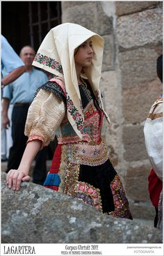 Portrait of a girl Lagarterana wearing traditional clothes, embroidery feast Corpus Christi, Lagartera, Toledo, Spain.