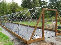 Build Your Own Greenhouse For Less Than The Cost of a Greenhouse Kit. Garden Row Covers, Low Tunnel, High Tunnel and Professional Grade, Greenhouse Hoop Benders. UV poly plastic and ground cloth for your homemade greenhouse. Build A Greenhouse, Greenhouse Growing, Greenhouse Gardening, Greenhouse Ideas, Greenhouse Wedding, Large Greenhouse, Aquaponics System, Hydroponics, Raised Beds