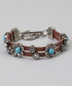 Love this Turquoise & Rhinestone Flower Brown Leather Bracelet on #zulily! #zulilyfinds