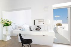 Design: Brilliant Bedroom Of Grace Santorini Hotel Near Clear Colored Bed Linen Along With Flipping Doors Which Have Clear Wooden Frame from Modern Hotel with Sensational Sea Panorama