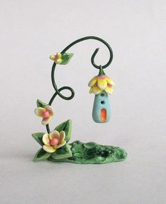 Polymer clay stand with house pendant/ornament