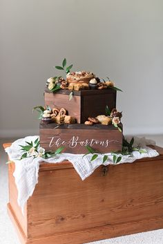 Chic dark wooden wedding cake box stands for desserts and that can be personalized and upcycled into plant stands after the event #weddingcake #cakestand #desserttable #weddingcakes #weddingideas #weddingdecor #weddings