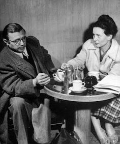 Simone de Beauvoir and Jean-Paul Sartre, two existentialist philosophers, conversing at a cafe