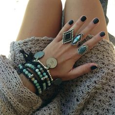 Gorgeous collection of turquoise and sterling worn with edgy black nails.