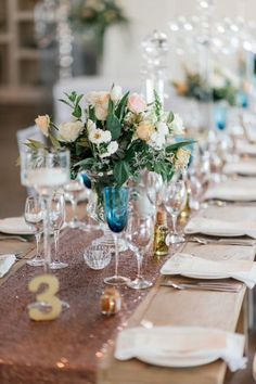 Peach, copper cream and blue wedding reception table decor - Eensgezind Durbanville Wedding