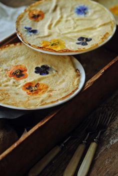 Viola crepes... In summer I can send the kids out at 5 am to collect fresh eggs, violas, and strawberries for these :D