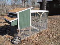 Scroll down in the article to see the chicken tractor.  Note that it is flat on the ground because the wheels stick out in front!  It can be moved like a wheelbarrow.