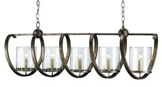 Whimsical spirals encircle the seeded glass shades of this bold five light fixture, an ideal choice for elongated spaces. The Maximus Rectangular Chandelier's masterfully crafted linear wrought iron f