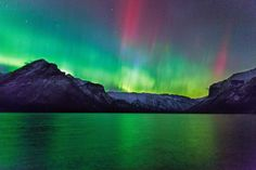 The Northern Lights, or aurora borealis, is caused by the collision of solar particles in the Earth's atmosphere.