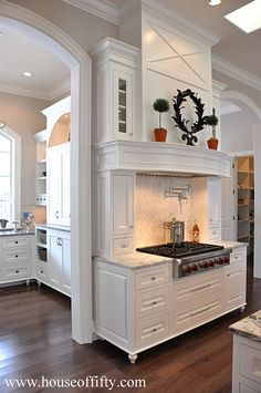 Kitchen Range Hood Design Ideas kitchen flat range hood stainless stove marble countertops brown kitchen cabinets kitchen Dreams Portland Portland Style Portland Walk Kitchens Pantries Nooks Kitchens Dining Rooms Dream Kitchens White Kitchens Luxury Kitchens House 6