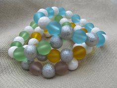 Set of three bracelets made of white faceted shell and sea glass beads bracelets, color of your choice by littlecrowshop, $42.00