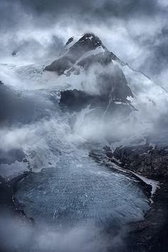 Clouds swirl around a peak (Coast Mountains, B.C.) by Exploring Light / 500px