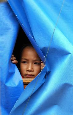 Child on a riverboat.  #Laos #Travel