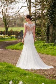 Style C17104, Lace wedding dress with illusion back.