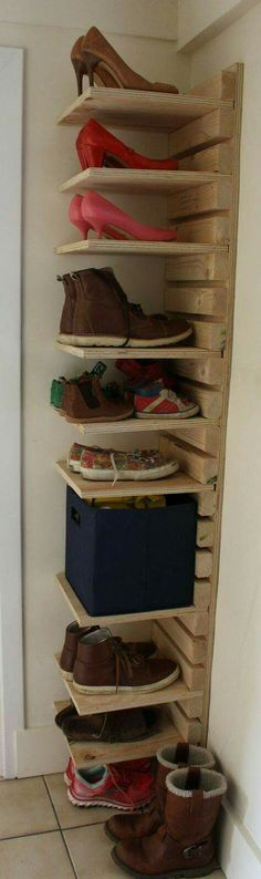 Got some scrap/reclaimed wood? Great vertical shoe storage idea....or books or bags...or toyys!