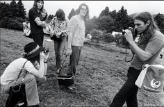 Nick Mason taking pictures of David Gilmour, David Gilmour taking pictures of…