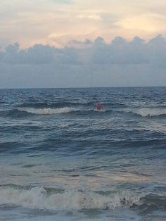 Surfer at North Carolina Beach, Wilmington NC