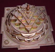 Sri Meru Yantra, produced by the Devipuram temple, Andhra Pradesh, India. The Sri Yantra (shown here in the three-dimensional projection known as Sri Meru or Maha Meru, used primarily by Srividya Shakta sects) is central to most Tantric forms of Shaktism. Sri Yantra, Yoga Studio Design, Lakshmi Images, Shiva Shakti, Shiva Hindu, Shiva Art, Sacred Symbols, Spiritual Symbols, Durga Goddess