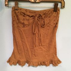 Ruffle tube top Olive green ruffle bottom tube top with eyelet design on top and tie loop Arizona Jean Company Tops Camisoles