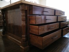 Solid frame and panel drawers on smooth glide wood slides.