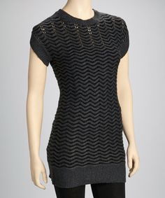 Cozy meets chic in this day-to-night sweater dress with a wave design and ribbed edges that add extra flair to its fierce figure-hugging silhouette.