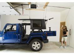 Is your garage filled with so much stuff there& no room for your Jeep? Here& a practical solution. Go vertical! With the Harken Hoister you can store recreational equipment such as kayaks and Jeep hardtops up and out of the way. Jeep Wrangler Tj, Jeep Rubicon, Jeep Wrangler Unlimited, Jeep Jku, Jeep Wrangler Accessories, Jeep Accessories, Kayak Storage, Garage Storage, Garage Organization