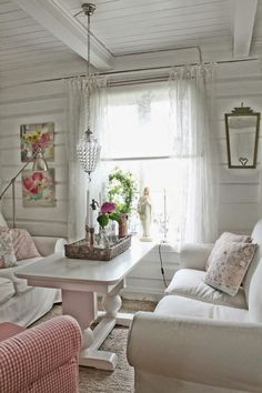 ♡༻shabby chic - notice the pretty ties on the curtains, and the Madonna in the window. Lovely