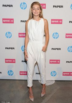 Day and night! Gigi Hadid shines in a white jumpsuit as Chanel Iman smoulders in sexy black dress at technology event in NYC Jumpsuit Dressy, White Jumpsuit, Jumpsuit Style, Kendall Jenner, Valentino Rockstud Heels, Chanel Iman, Gigi Hadid Style, Heels Outfits, White Outfits