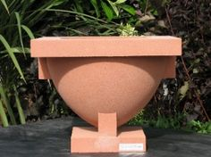 The Westcott House Vase is a concrete cast stone Frank Lloyd Wright reproduction made by Nichols Bros. Stoneworks. The Westcott urns were the largest concrete planters designed by Frank Lloyd Wright.
