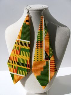 Can you believe these right here are Earrings ? #African Inspired
