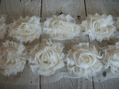 this shop has a lot of lace and cute flowers, too!  Chiffon Shabby Chic Rose Trim in IVORY -2 1/2 inch Flower-1/2 yard