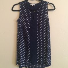 Navy and White Polka Dot Sleeveless Blouse Minor wear near button, good condition otherwise and very light weight! Tag says XL more like a large but still a looser type fit. Tops Blouses