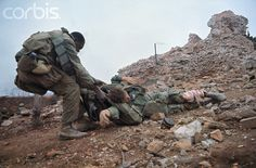 https://flic.kr/p/fZgRJE | 16 Feb 1968 - Phu Xuan Citadel, Thua Thien-Hue Province | South Vietnam - A U.S Marine keeps his head low as he drags a wounded buddy from the ruins of the Citadel's outer wall during fighting. --- Image by © Bettmann/CORBIS United States Marine Corps