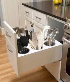 We LOVE this secrete and highly utilized kitchen utensils organizer. To the average person, this cabinet in the base, looks like a usual 3 drawer base cabinet config. When you pull the top drawer, you find this awesome place to place utensils without storing them on your kitchen counter top! SHOP CABINETS @ www.CabinetMania.com